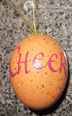 Decorated egg with decoupage to seal on top of shell and rub-on sticker