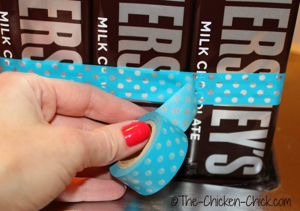 Washi tape or ribbon holds the candy in place a little more securely and adds a pop of color