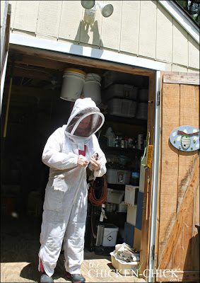 Brenda suiting up in her beekeeper's gear. Safety first!