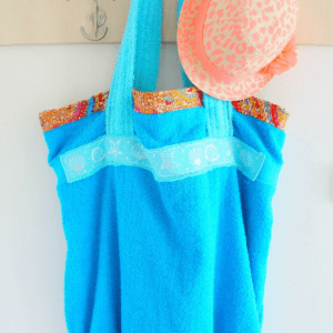 Easy DIY Towel Beach Bag, shared by The Seaman Mom