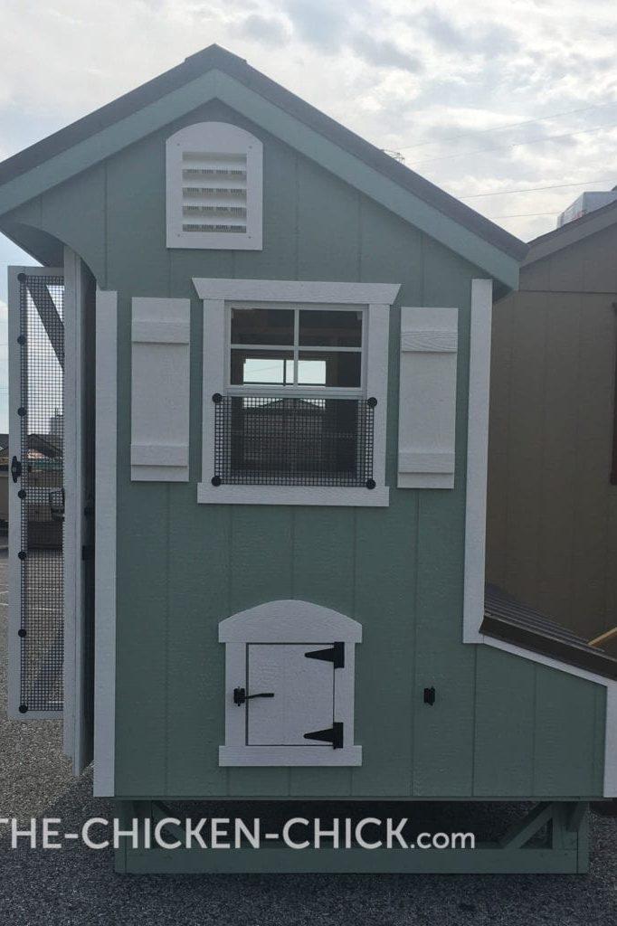 The Chicken Chick's Essential Coop™ predator-proofed window above pop door